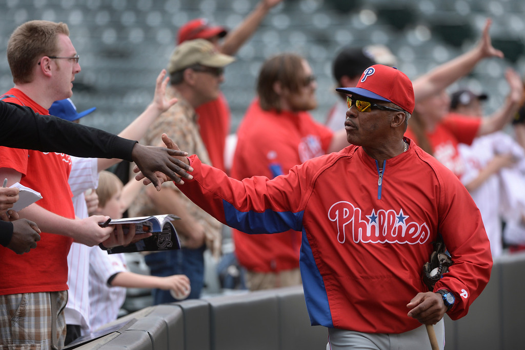 . DENVER, CO - APRIL 18: Philadelphia base coach Juan Samuel visited with fans before the game Friday night. The Colorado Rockies hosted the Philadelphia Phillies Friday night, April 18, 2014 at Coors Field.  (Photo by Karl Gehring/The Denver Post)