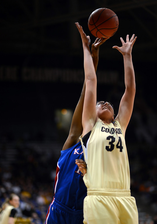 . BOULDER, CO. - MARCH 23: Jen Reese of Colorado Buffaloes (34) controls the rebound against Chelsea Gardner of Kansas Jayhawks (15) during the first round of the 2013 NCAA women\'s Basketball Tournament at Coors Events Center. Boulder, Colorado. March 23, 2013. (Photo By Hyoung Chang/The Denver Post)