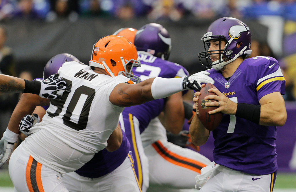 . Minnesota Vikings quarterback Christian Ponder, right, is pressured by Cleveland Browns defensive end Billy Winn during the first half of an NFL football game Sunday, Sept. 22, 2013, in Minneapolis. (AP Photo/Ann Heisenfelt)
