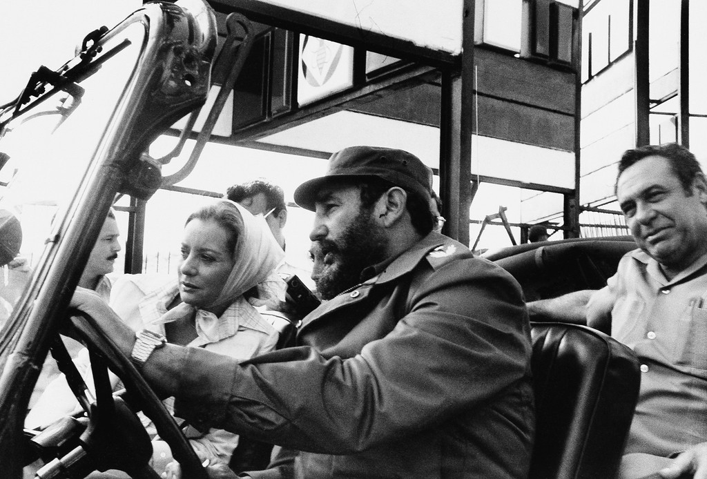 """. FILE - This June 6, 1977 file photo shows ABC news correspondent Barbara Walters, left, being driven by Cuban leader Fidel Castro on a sightseeing tour in Cuba.  On Friday, May 16, 2014, capping a spectacular half-century run she began as the so-called \""""Today\"""" Girl, Walters will exit ABC\'s \""""The View.\"""" Behind the scenes she will remain as an executive producer of the New York-based talk show she created 17 years ago, and make ABC News appearances as events warrant and stories catch her interest.  (AP Photo/ABC, File)"""