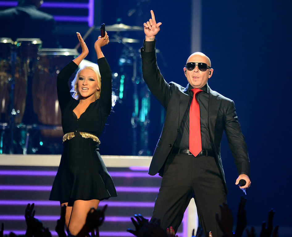 . Musicians Pitbull and Christina Aguilera perform onstage during the 2013 Billboard Music Awards at the MGM Grand Garden Arena on May 19, 2013 in Las Vegas, Nevada.  (Photo by Ethan Miller/Getty Images)