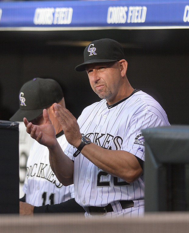 . DENVER, CO - JUNE 20: Rockies\' skipper Walt Weiss applauded his team\'s effort from the dugout in the first inning. The Colorado Rockies hosted the Milwaukee Brewers at Coors Field Friday night, June 20, 2014. Photo by Karl Gehring/The Denver Post