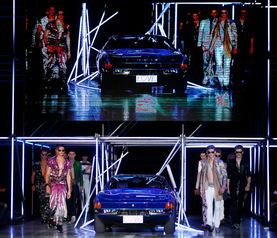 . Models wear creations for Roberto Cavalli men\'s Spring-Summer 2015 collection, part of the Milan Fashion Week, unveiled in Milan, Italy, Tuesday, June 24, 2014. (AP Photo/Luca Bruno)