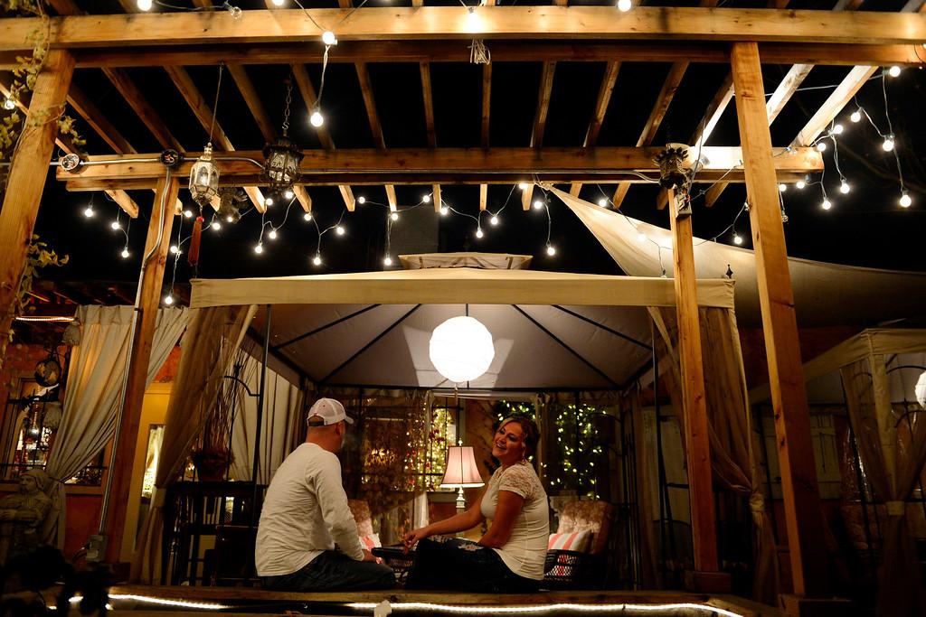 . Fred Samborski (left) and Stefani Mattson enjoy happy hour at Black Crown Lounge on Sunday, November 25, 2012. AAron Ontiveroz, The Denver Post