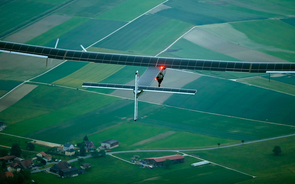 . German test pilot Markus Scherdel steers the solar-powered Solar Impulse 2 aircraft for its maiden flight at its base in Payerne, Switzerland Monday,  June 2, 2014. The aircraft is the second solar plane of the Solar Impulse project. The main goal of the project is to circumnavigate the world with an aircraft, powered only by solar energy.  (AP Photo/Denis Balibouse,Pool)