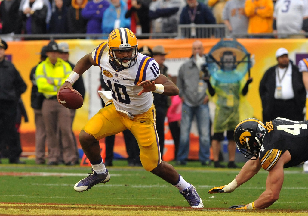 . Quarterback Anthony Jennings #10 of the LSU Tigers runs from the pocket in the second quarter against the Iowa Hawkeyes January 1, 2014  in the Outback Bowl at Raymond James Stadium in Tampa, Florida.  (Photo by Al Messerschmidt/Getty Images)