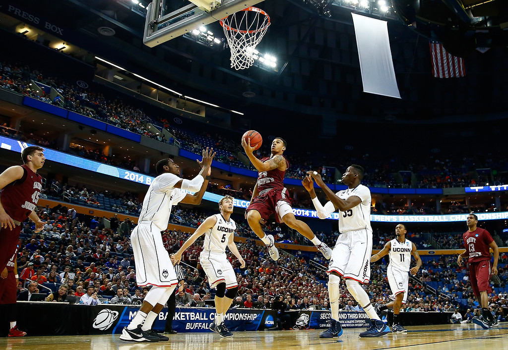 . BUFFALO, NY - MARCH 20:  Chris Wilson #24 of the Saint Joseph\'s Hawks goes to the basket against the Connecticut Huskies during the second round of the 2014 NCAA Men\'s Basketball Tournament at the First Niagara Center on March 20, 2014 in Buffalo, New York.  (Photo by Jared Wickerham/Getty Images)