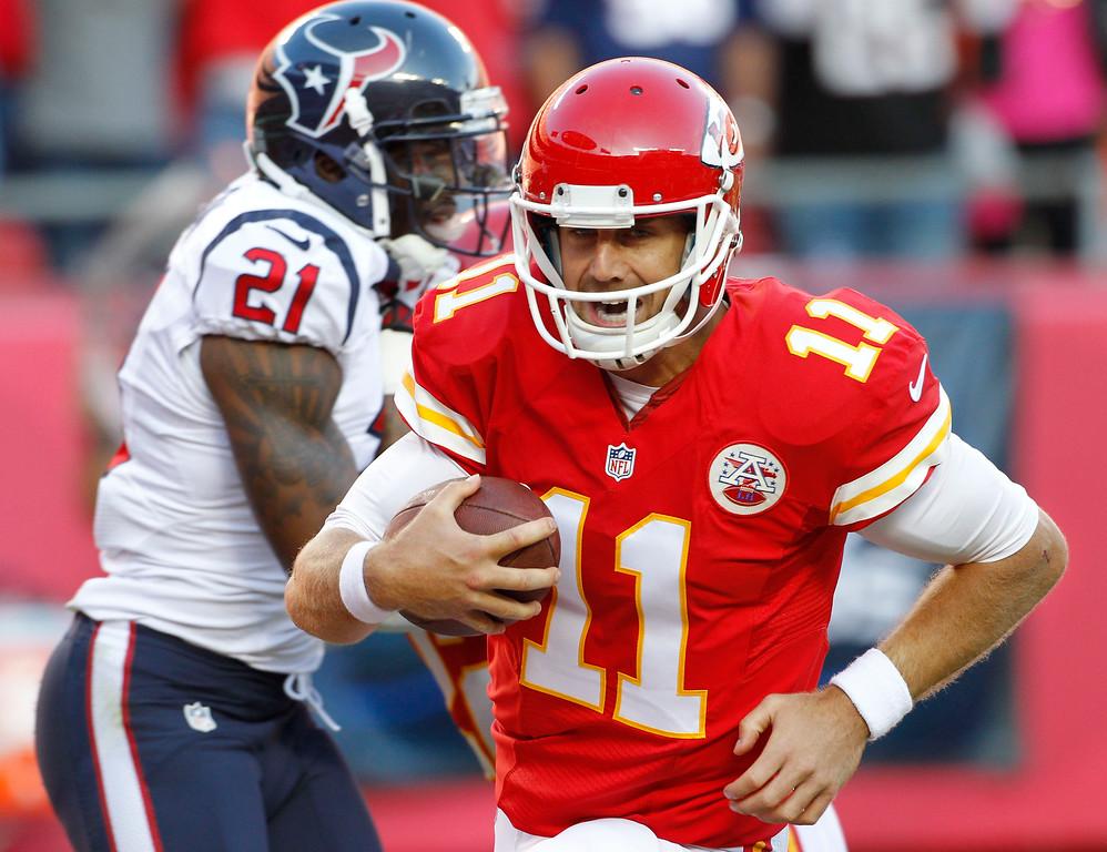 . Kansas City Chiefs quarterback Alex Smith (11) runs past Houston Texans cornerback Brice McCain (21) for a touchdown during the first half of an NFL football game at Arrowhead Stadium in Kansas City, Mo., Sunday, Oct. 20, 2013. (AP Photo/Colin E. Braley)