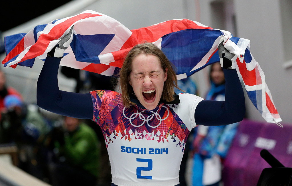 . Elizabeth Yarnold of Great Britain celebrates her gold medal win during the women\'s skeleton competition at the 2014 Winter Olympics, Friday, Feb. 14, 2014, in Krasnaya Polyana, Russia. (AP Photo/Michael Sohn)