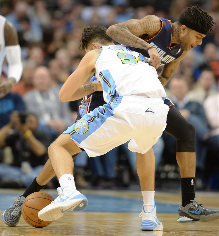 . Evan Fournier of the Denver Nuggets (94) steals the ball from Chris Douglas-Roberts of the Charlotte Bobcats (55) in the second half. (Photo by Hyoung Chang/The Denver Post)