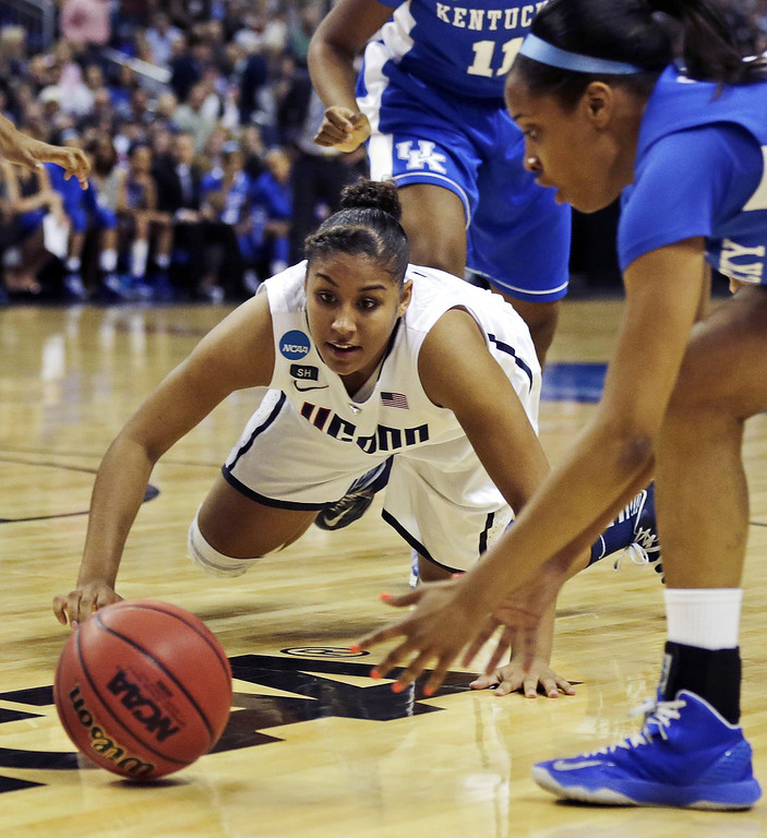 . Connecticut forward Kaleena Mosqueda-Lewis, left, dives for the ball against Kentucky guard Bria Goss, right, in the first half of a women\'s NCAA regional final basketball game in Bridgeport, Conn., Monday, April 1, 2013. (AP Photo/Charles Krupa)