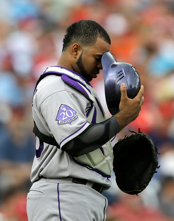 . Colorado Rockies catcher Wilin Rosario pauses before the first pitch of a baseball baseball game against the Washington Nationals at Nationals Park, Sunday, June 23, 2013, in Washington. (AP Photo/Carolyn Kaster)