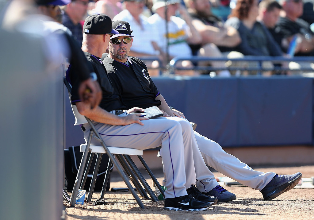 . Manager Walt Weiss (R) #22 of the Colorado Rockies watches from the bench during the spring training game against the Seattle Mariners at Peoria Stadium on March 3, 2014 in Peoria, Arizona.  (Photo by Christian Petersen/Getty Images)