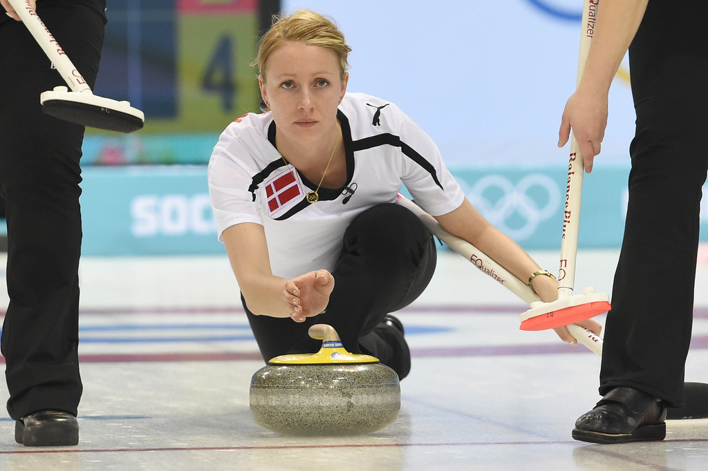 . Denmark\'s Helle Simonsen throws the stone during the Women\'s Curling Round Robin Session 6 against Sweden at the Ice Cube Curling Center during the Sochi Winter Olympics on February 13, 2014. DAMIEN MEYER/AFP/Getty Images