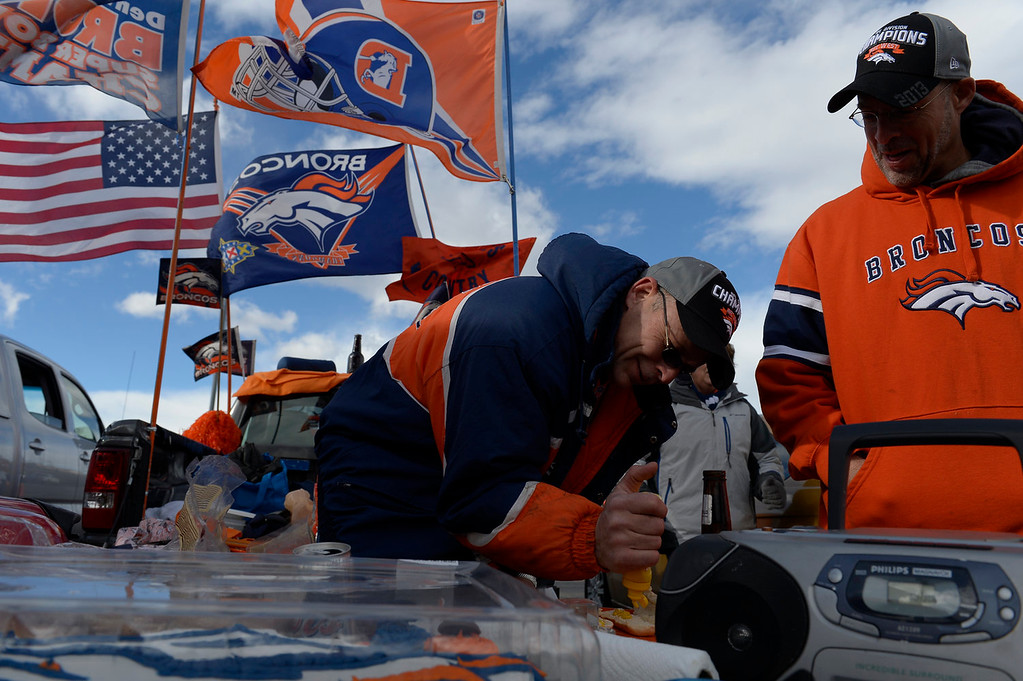 . Spencer Kuhl grills before the game. The Denver Broncos take on the San Diego Chargers at Sports Authority Field at Mile High in Denver on January 12, 2014. (Photo by Craig F. Walker/The Denver Post)