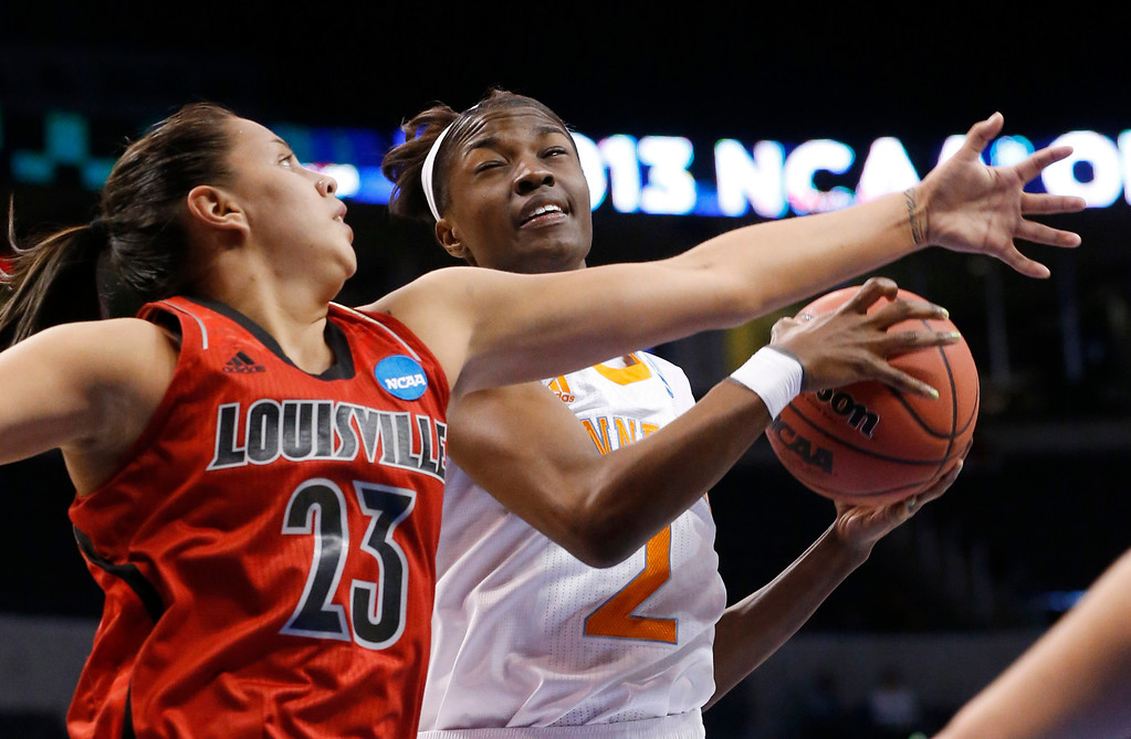 . Tennessee forward Jasmine Jones (2) grabs a rebound next to Louisville guard Shoni Schimmel (23) in the first half of the Oklahoma City regional final in the NCA women\'s college basketball tournament in Oklahoma City, Tuesday, April 2, 2013.  (AP Photo/Sue Ogrocki)