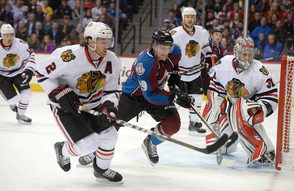 . Colorado Avalanche center Nathan MacKinnon (29) races to the puck with Chicago Blackhawks defenseman Duncan Keith (2) during the first period November 19, 2013 at Pepsi Center. (Photo by John Leyba/The Denver Post)