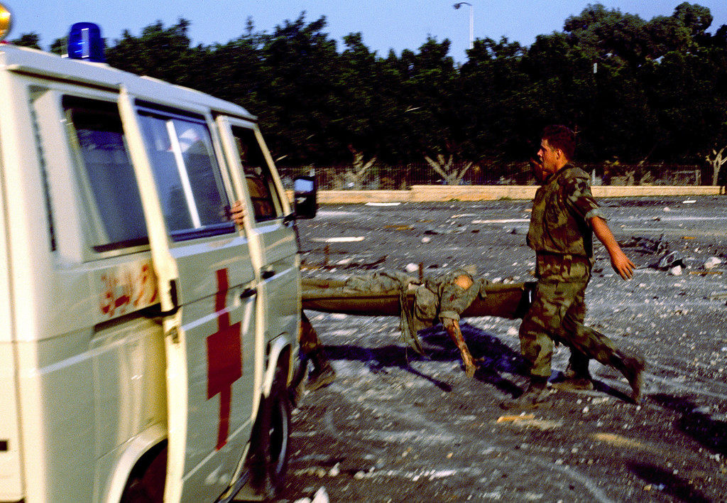 . In this Sunday, Oct. 23, 1983, file photo, an injured service member is carried on a stretcher after a suicide truck bomb struck the U.S. Marine barracks in Beirut, Lebanon. (AP Photo, File)
