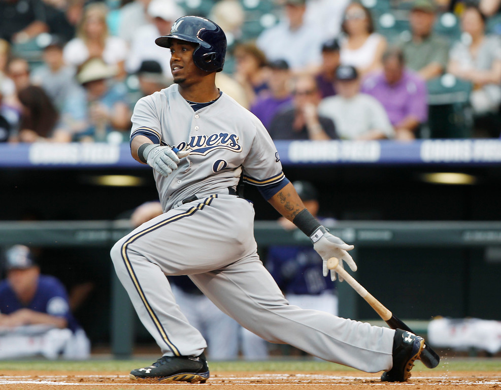 . Milwaukee Brewers\' Jean Segura follows he flight of his RBI-single against the Colorado Rockies in the first inning of a baseball game in Denver on Saturday, July 27, 2013. (AP Photo/David Zalubowski)