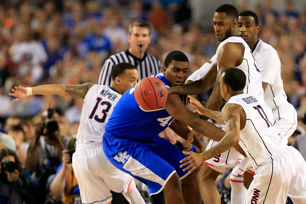 . ARLINGTON, TX - APRIL 07: Dakari Johnson #44 of the Kentucky Wildcats battles for a loose ball against Phillip Nolan #0 and Ryan Boatright #11 of the Connecticut Huskies during the NCAA Men\'s Final Four Championship at AT&T Stadium on April 7, 2014 in Arlington, Texas.  (Photo by Jamie Squire/Getty Images)