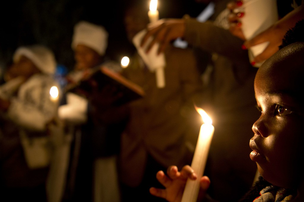 . A group of well wishers hold candles as they pray for the recovery of Nelson Mandela outside the Mediclinic heart hospital in Pretoria on June 26, 2013. Mandela is receiving treatment at the Mediclinic heart hospital in Pretoria. Mandela\'s close family gathered yesterday at his rural homestead to discuss the failing health of the South African anti-apartheid icon who was fighting for his life in hospital. Messages of support poured in from around the world for the Nobel Peace Prize winner, who spent 27 years behind bars for his struggle under white minority rule and went on to become South Africa\'s first black president. ODD ANDERSEN/AFP/Getty Images
