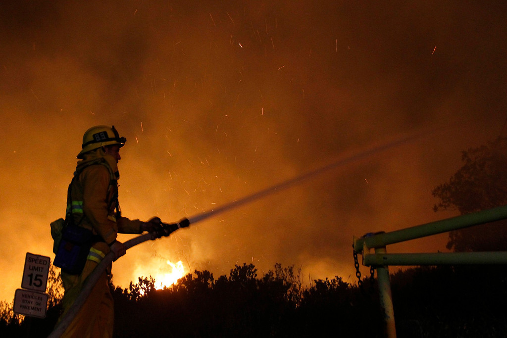 . A firefighter battles the Springs Fire at Point Mugu State Park, May 3, 2013. REUTERS/Jonathan Alcorn