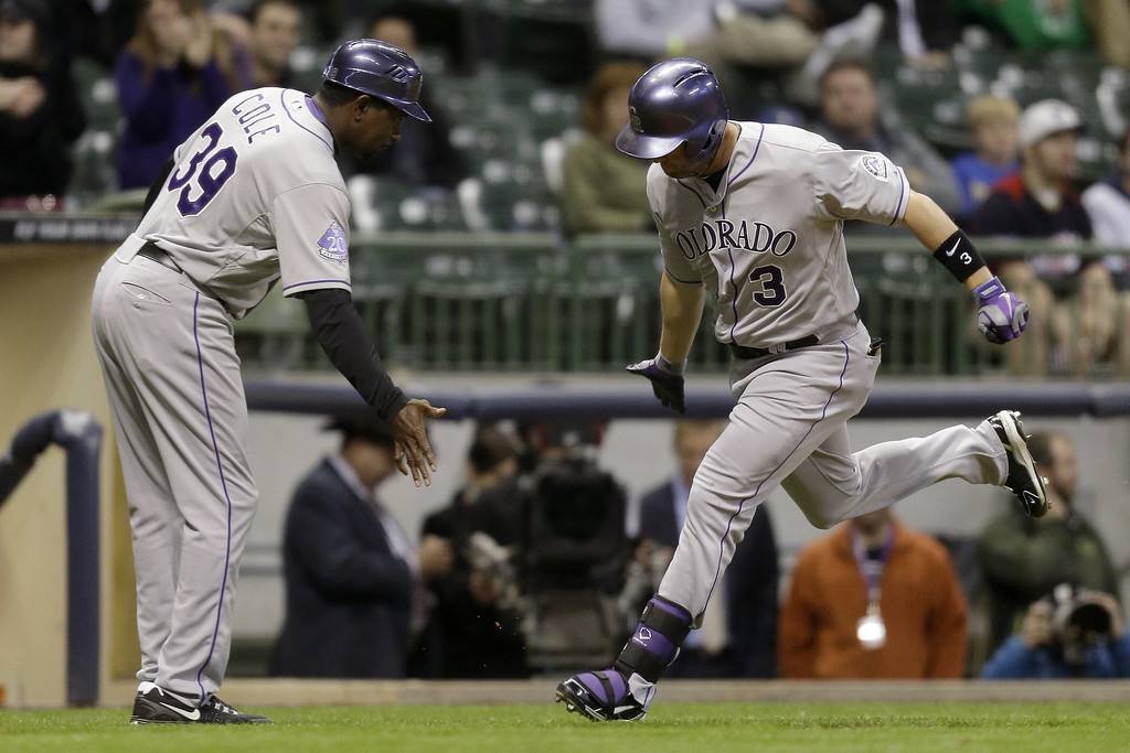 . MILWAUKEE, WI - APRIL 3:  Michael Cuddyer #3 of the Colorado Rockies runs the bases after hitting a two-run homer scoring Reid Brignac in the top of the ninth inning against the Milwaukee Brewers at Miller Park on April 3, 2013 in Milwaukee, Wisconsin. (Photo by Mike McGinnis/Getty Images)