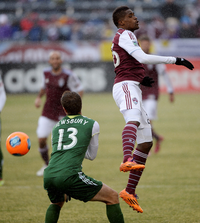 . COMMERCE CITY MARCH 22: DeShorn Brown of Colorado Rapids (26), right, and Jack Jewsbury of  Portland Timbers (13) are in action during the 1st half of the game at Dick\'s Sporting Goods Park. Commerce City, Colorado. March 22. 2014. Colorado won 2-0. (Photo by Hyoung Chang/The Denver Post)