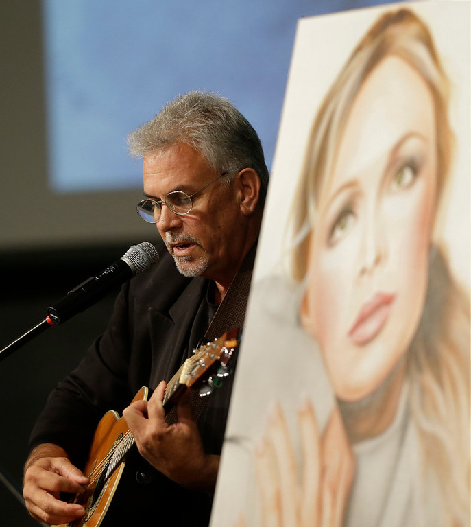 . Michael Inge, stepfather of country music star Mindy McCready, plays a song during the funeral ceremony at the Crossroads Baptist Church in Fort Myers, Fla., Tuesday, Feb. 26, 2013.  McCready committed suicide Feb. 17 at her home in Arkansas, days after leaving a court-ordered substance abuse program. (AP Photo/Alan Diaz)