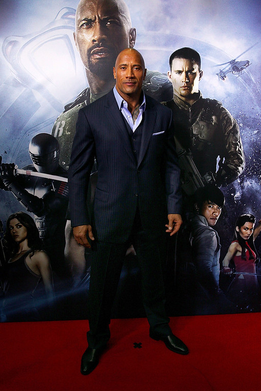 ". Dwayne Johnson arrives at the ""G.I.Joe: Retaliation\"" - Australian Premiere at Event Cinemas George Street on March 14, 2013 in Sydney, Australia.  (Photo by Lisa Maree Williams/Getty Images)"
