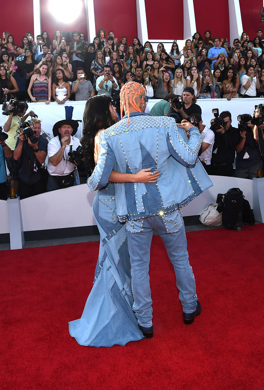 . Rapper Riff Raff (L) and singer Katy Perry attend the 2014 MTV Video Music Awards at The Forum on August 24, 2014 in Inglewood, California.  (Photo by Larry Busacca/Getty Images for MTV)