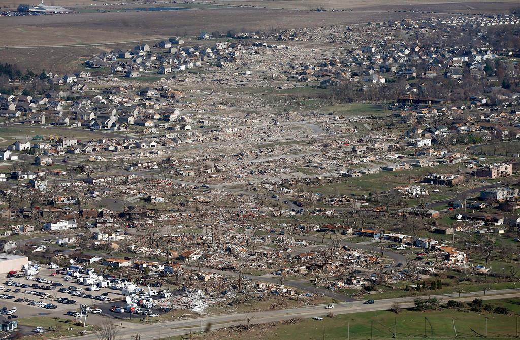 . This aerial view on Monday, Nov. 18, 2013, shows the path of a tornado that hit the western Illinois town of Washington. It was one of the worst-hit areas after intense storms and tornadoes swept through Illinois. The National Weather Service says the tornado that hit Washington had a preliminary rating of EF-4, meaning wind speeds of 170 mph to 190 mph. (AP Photo/Charles Rex Arbogast)