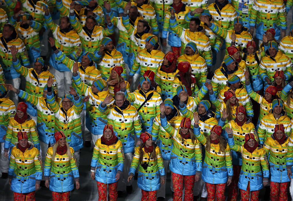 . Members of the German delegation wave during the Opening Ceremony of the Sochi Winter Olympics at the Fisht Olympic Stadium on February 7, 2014 in Sochi. AFP PHOTO / ADRIAN DENNIS/AFP/Getty Images