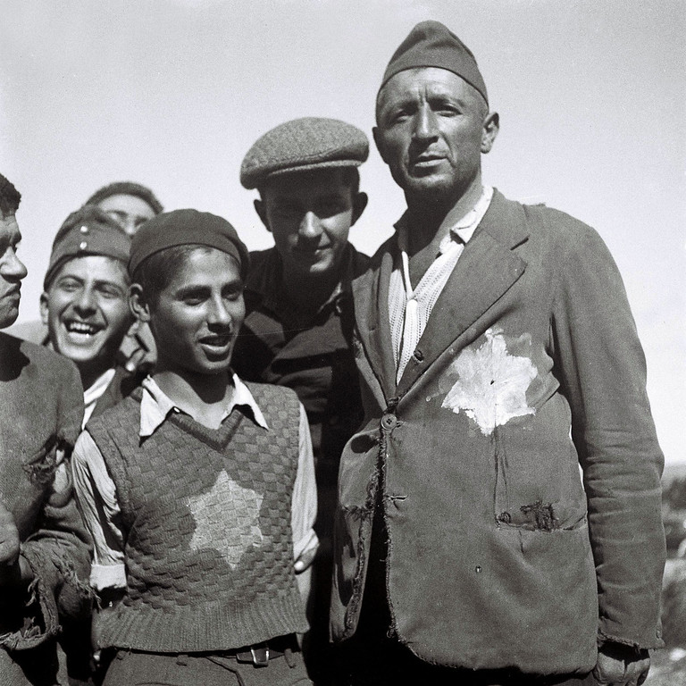 . ATLIT, MANDATE PALESTINE - NOVEMBER 4, 1944: Jewish survivors of the Nazi concentration camps in Europe still wear the signs of their ordeal on their tattered clothing at the new immigrants\' reception camp November 4, 1944 at Atlit, during the British Mandate of Palestine, in what would later become the State of Israel. (Photo by Zoltan Kluger/GPO via Getty Images)