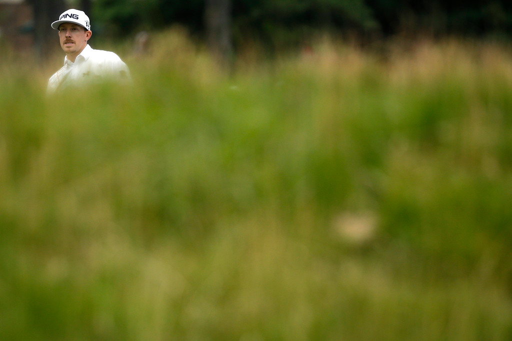 . Hunter Mahan checks his lie on the eighth hole during the fourth round of the U.S. Open golf tournament at Merion Golf Club, Sunday, June 16, 2013, in Ardmore, Pa. (AP Photo/Morry Gash)