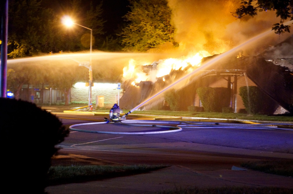 . A firefighter battles a blaze at Howe Mortuary about 2 a.m. Tuesday, May 24, 2013. (Nate Kenworthy, courtesy photo)