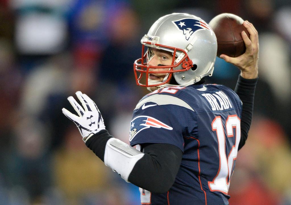 . New England Patriots quarterback Tom Brady (12) throws a pass during the third quarter against the Denver Broncos November 24, 2013 at Gillette Stadium. (Photo by John Leyba/The Denver Post)