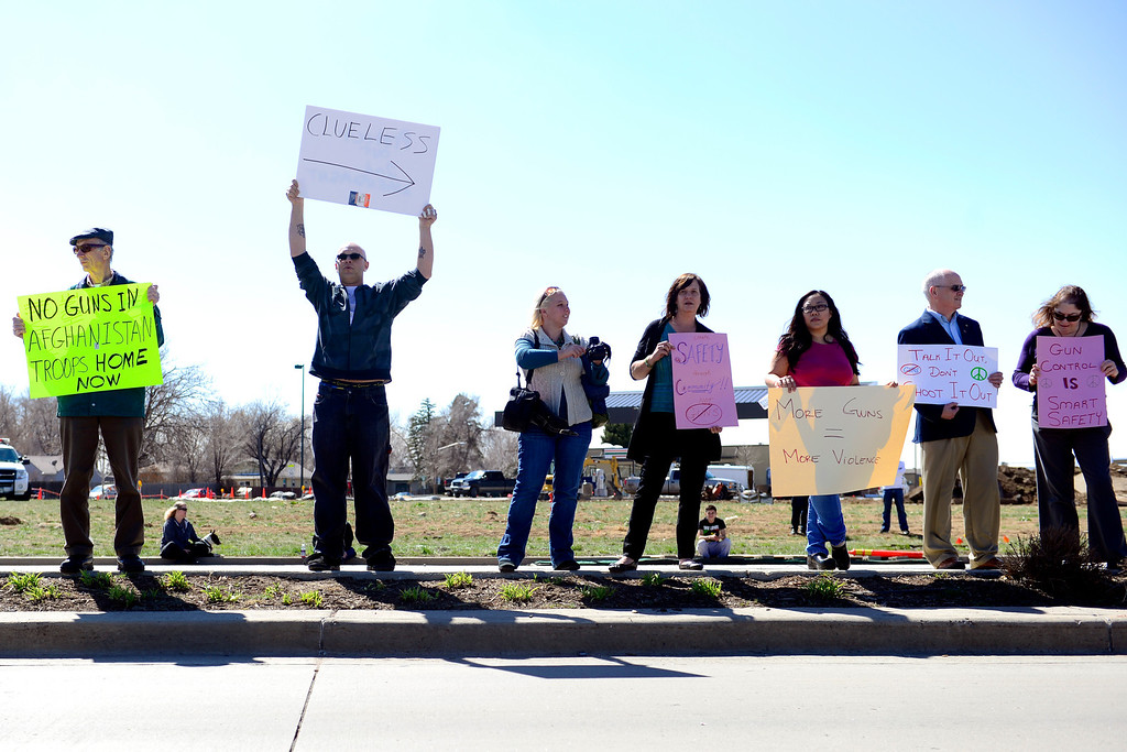 . DENVER, CO - APRIL 3: A pro-gun supporter mocks anti-gun protestors during a speech by Barack Obama during a speech at the Denver Police Academy. Both sides gathered outside of the complex to share their respective views. (Photo by AAron Ontiveroz/The Denver Post)