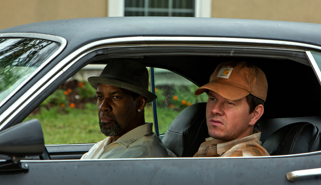 ". Left to right; Denzel Washington is a DEA agent and Mark Wahlberg a member of naval intelligence in the action film, ""2 Guns.\"" Provided by Universal"