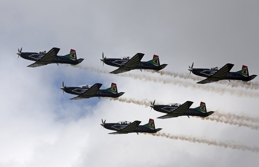 . Planes fly overhead during the burial of former South African president Nelson Mandela in  Qunu, South Africa, Sunday, Dec. 15, 2013.  (AP Photo/Schalk van Zuydam)