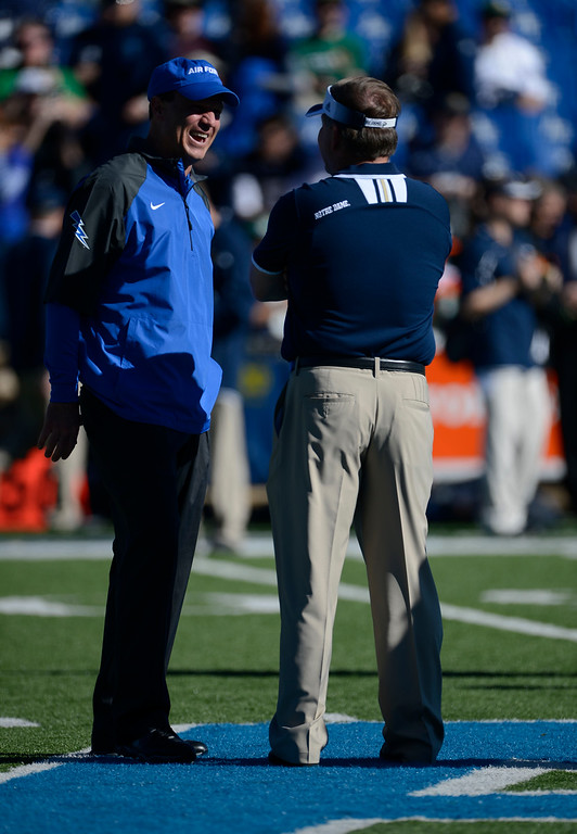 . COLORADO SPRINGS, CO - OCTOBER 26: Air Force head coach, Troy Calhoun, left, has a laugh with  Notre Dame head coach, Brian Kelly, at mid-field before the game at Falcon Stadium Saturday afternoon, October 26, 2013. (Photo By Andy Cross/The Denver Post)