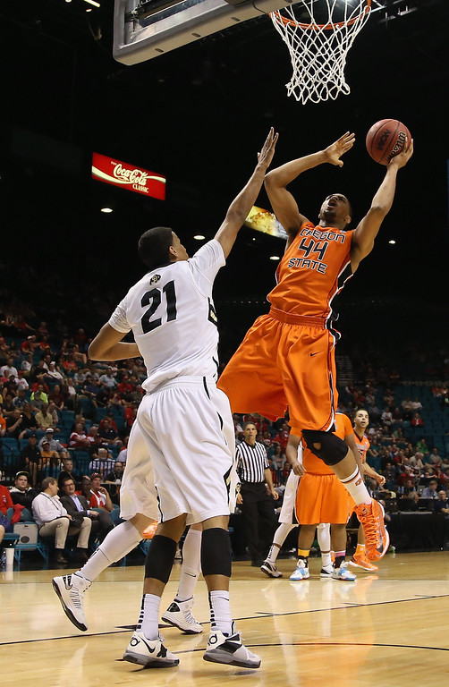 . LAS VEGAS, NV - MARCH 13:  Devon Collier #44 of the Oregon State Beavers drives to the basket over Andre Roberson #21 of the Colorado Buffaloes for a layup in the second half during the first round of the Pac 12 Tournament at the MGM Grand Garden Arena on March 13, 2013 in Las Vegas, Nevada.  Colorado defeated Oregon State 74-68.  (Photo by Jeff Gross/Getty Images)