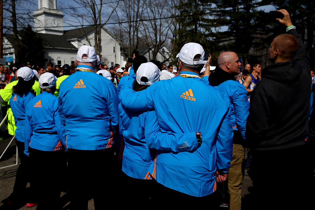 . Volunteers look on as Wave 1 starts the 118th Boston Marathon on April 21, 2014 in Hopkinton, Massachusetts.  (Photo by Alex Trautwig/Getty Images)