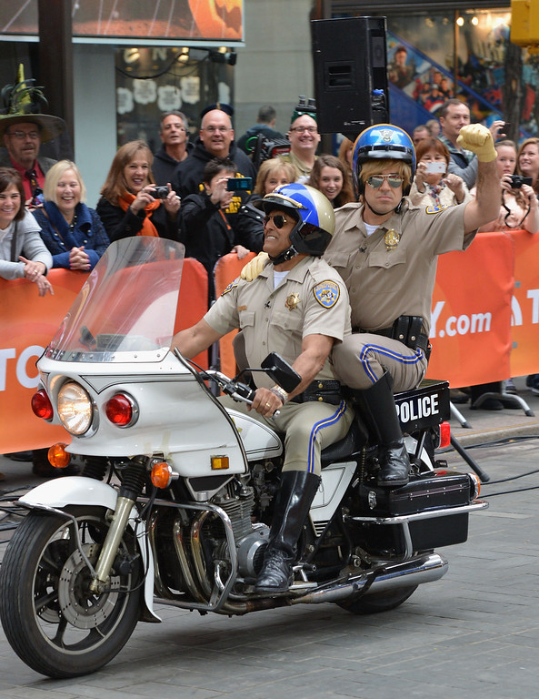""". Carson Daly (L) and Erik Estrada, dressed as characters from CHiPs, attend NBC\'s \""""Today\"""" Halloween 2013 in Rockefeller Plaza on October 31, 2013 in New York City.  (Photo by Slaven Vlasic/Getty Images)"""