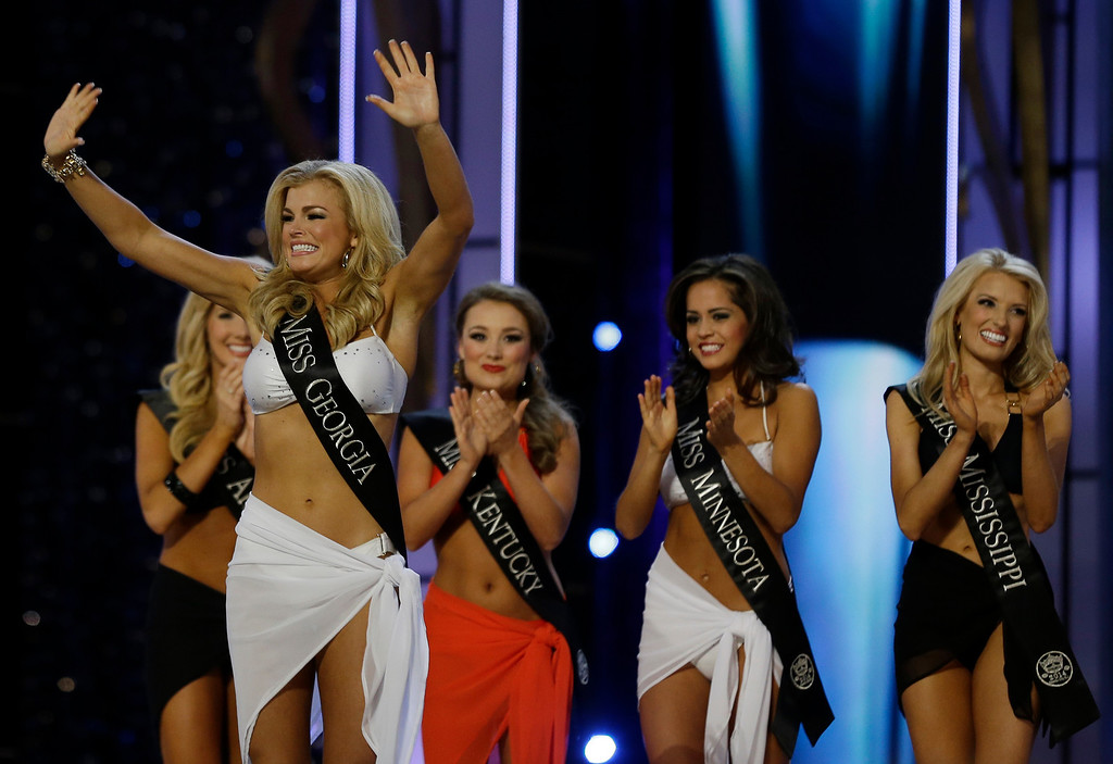 . Miss Georgia Carly Mathis acknowledges the crowd after advancing beyond the lifestyle competition during the Miss America 2014 pageant, Sunday, Sept. 15, 2013, in Atlantic City, N.J. (AP Photo/Mel Evans)