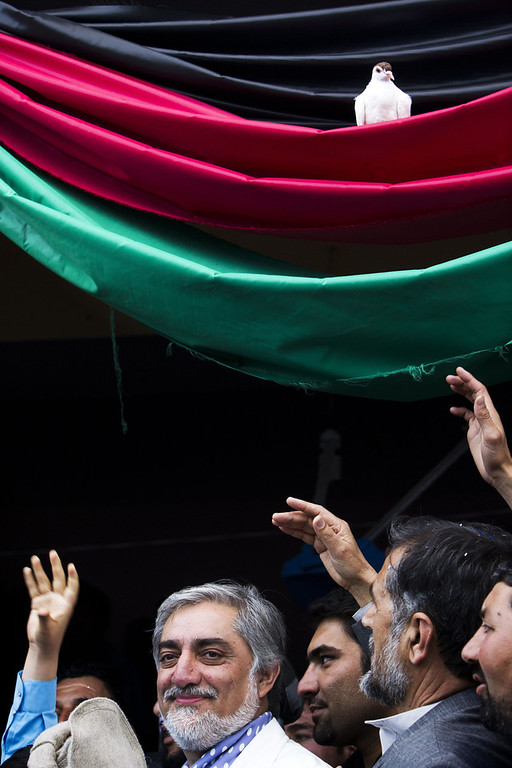 . Afghan presidential candidate Abdullah Abdullah smiles as a pigeon sits on a tri-colour Afghan flag during a campaign rally at a stadium in the northwestern city of Herat on April 1, 2014. Afghanistan will vote on April 5 to choose a successor to President Hamid Karzai and to decide the make-up of 34 provincial councils in elections seen as a benchmark of progress since the Taliban were ousted from power in 2001. (BEHROUZ MEHRI/AFP/Getty Images)