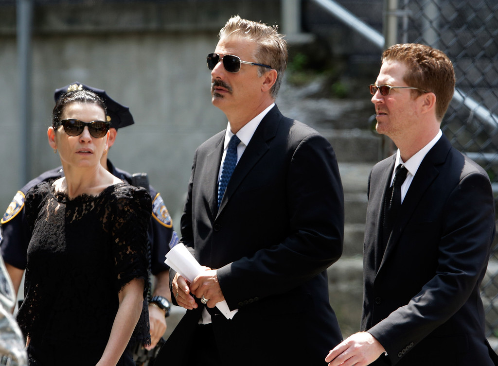 ". Actors Julianna Margulies, left, and Chris Noth, center, leave the funeral service of James Gandolfini, star of ""The Sopranos,\"" in New York\'s the Cathedral Church of Saint John the Divine,  Thursday, June 27, 2013. (AP Photo/Richard Drew)"