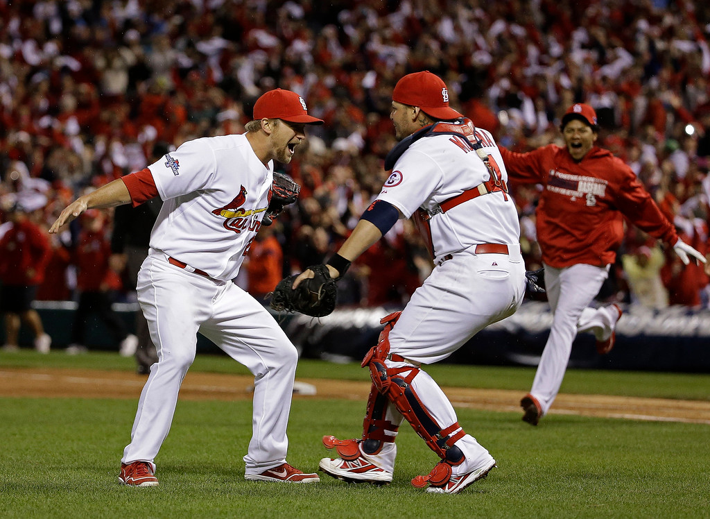. St. Louis Cardinals catcher Yadier Molina and Trevor Rosenthal celebrate after Game 6 of the National League baseball championship series against the Los Angeles Dodgers Friday, Oct. 18, 2013, in St. Louis. The Cardinals won 9-0 to win the series. (AP Photo/David J. Phillip)