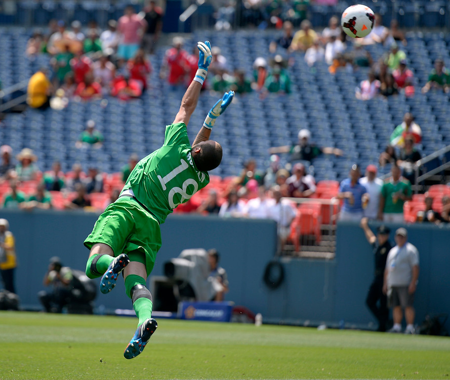 . Milan Borjan #18 of Canada makes a save on a shot by Jairo Jimenez #18 of Panama during the second half of the CONCACAF Gold Cup soccer game July 14, 2013 at Sports Authority Field at Mile High. (Photo By John Leyba/The Denver Post)