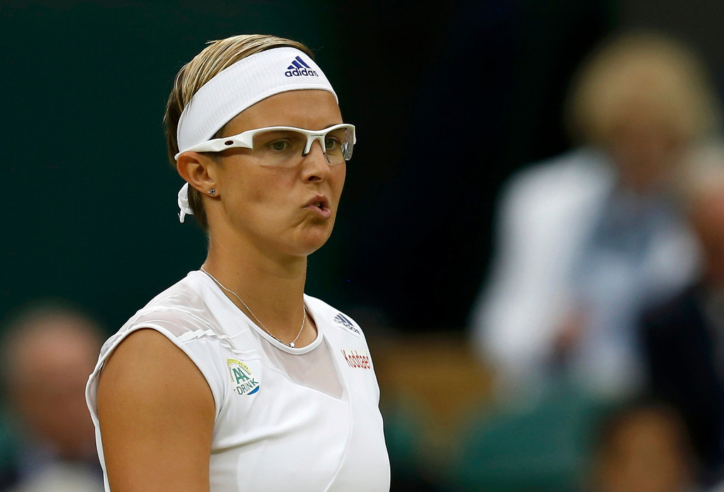 . Kirsten Flipkens of Belgium reacts during her women\'s quarter-final tennis match against Petra Kvitova of the Czech Republic at the Wimbledon Tennis Championships, in London July 2, 2013. REUTERS/Suzanne Plunkett